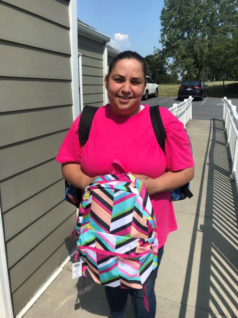 woman holding a school kit bag
