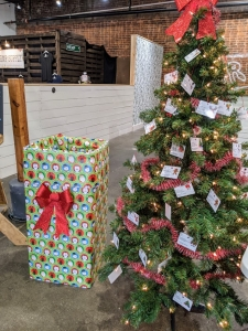 Giving Tree with donation box at Agora Downtown Market